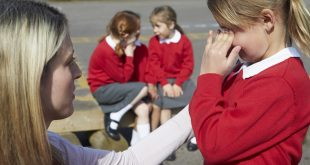 teacher comforts bullied child