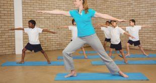 Students and teacher doing yoga pose