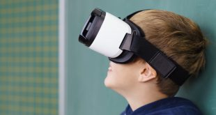 student in classroom with Augmented reality glasses