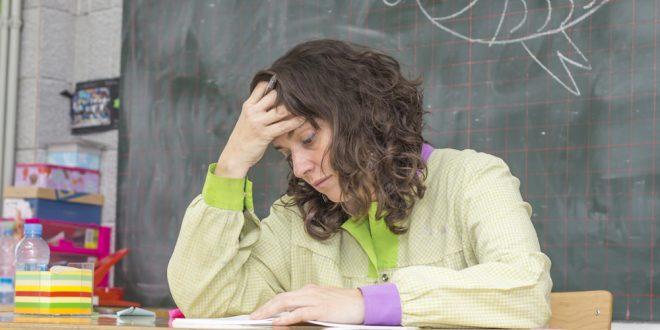 Tired teacher in classroom
