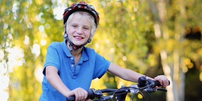 Happy boy riding on bike
