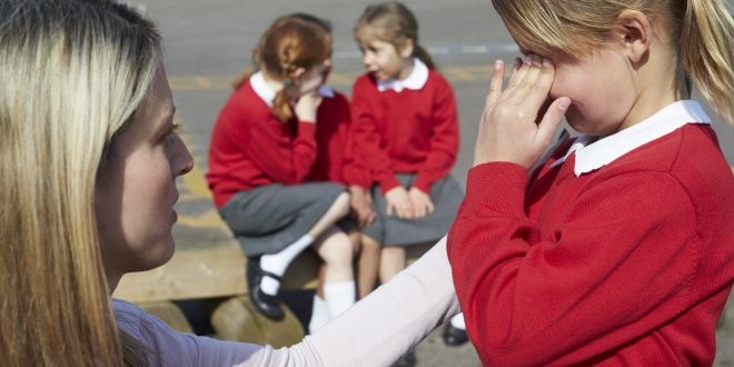 teacher comforts bullied child