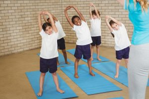 students stretching before yoga class