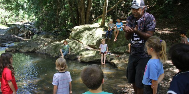 Kabi Kabi educator Lyndon Davis with River School kids at their creek