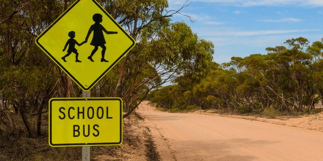 School bus stop warning road sign Australian rural outback