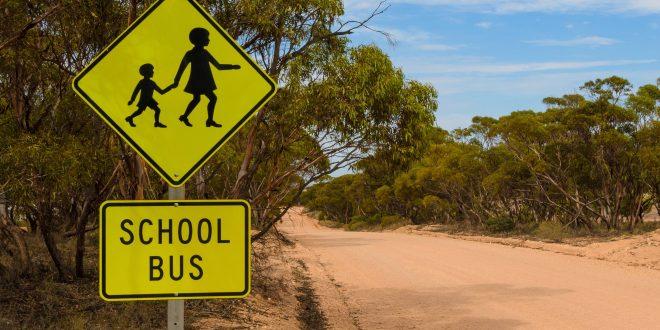 School bus stop warning road sign Australian rural outback