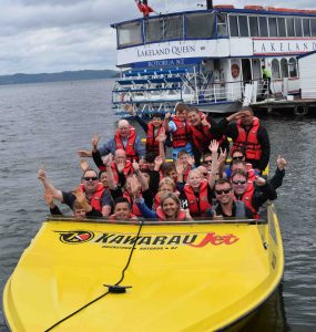 A group enjoying a Jet boat ride in New Zealand. Photo: Horizons Sports Tours