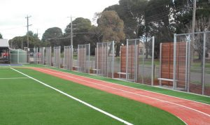 Custom timber panels with galvanised tubular steel and weld mesh. Photo: Lee Brothers Group Fencing