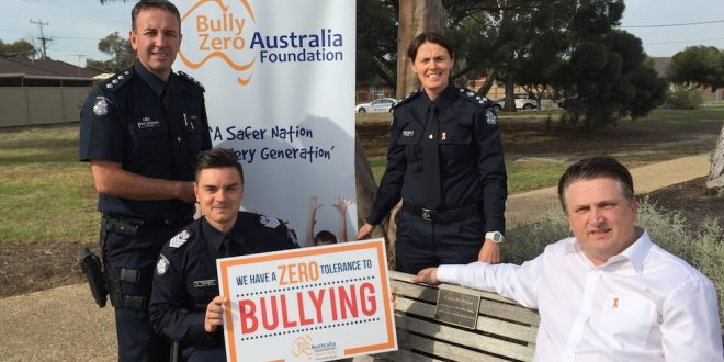 Ali Halkic with Senior Sergeant John Travaglini and Vic Police
